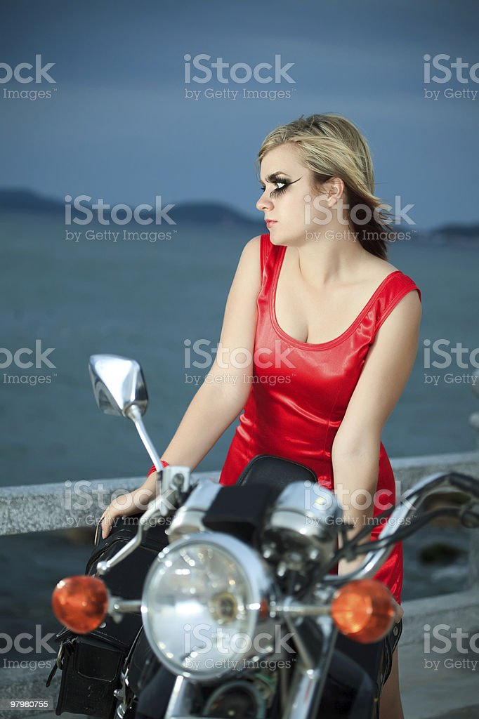 Woman with a motorcycle royalty-free stock photo