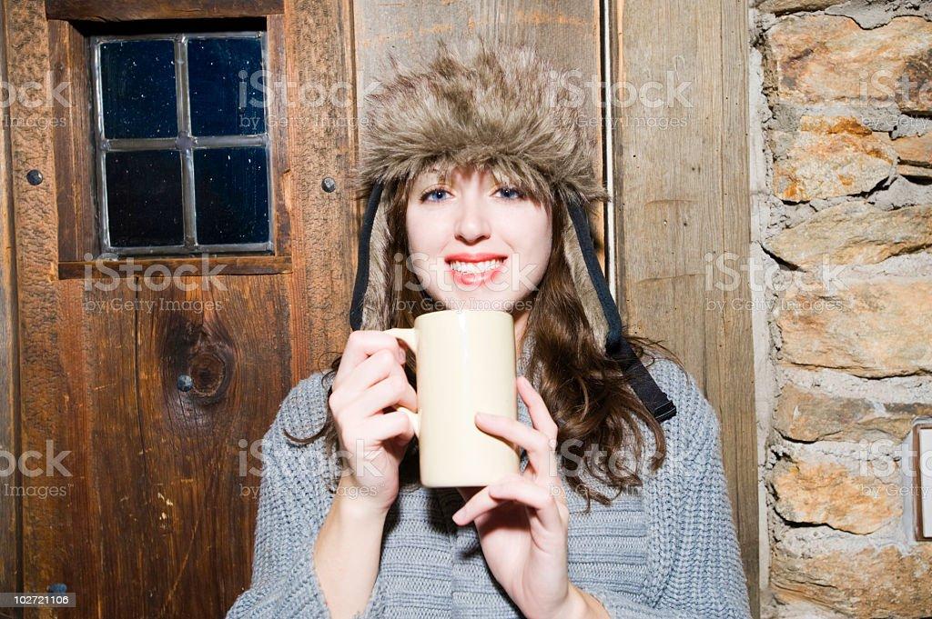 Woman with a mug smiling stock photo