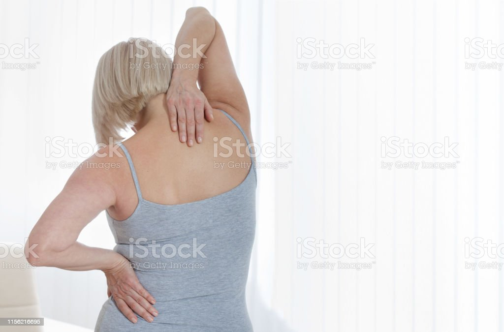 Middle aged woman with a pain in the body. Concept photo with...