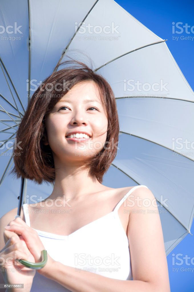 Woman with a parasol royalty-free stock photo