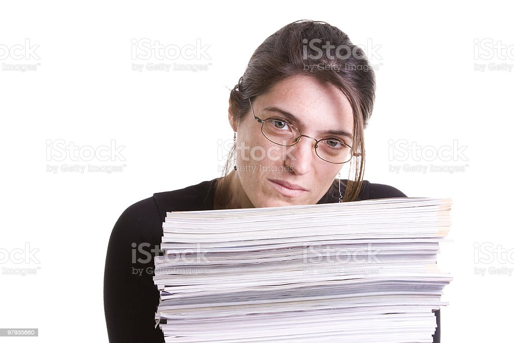 Woman with a pile of books royalty-free stock photo