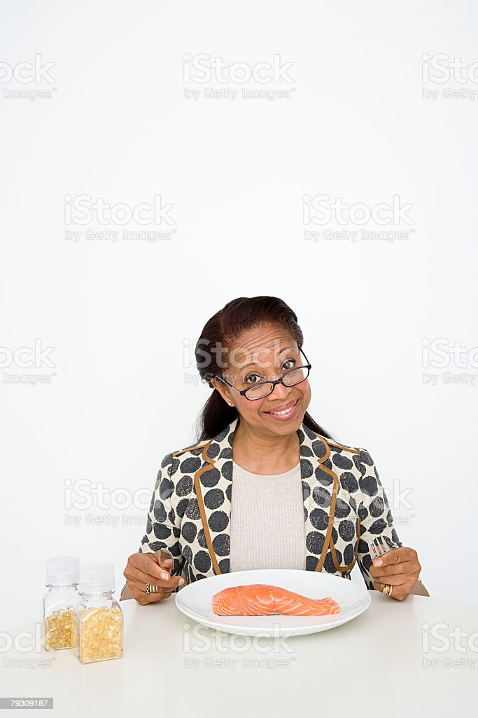 Woman with a plate of salmon 免版稅 stock photo