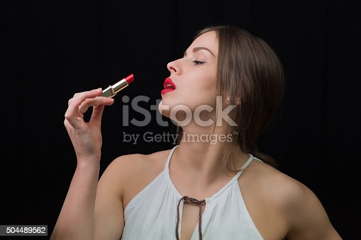 istock Woman with a red lipstick 504489562