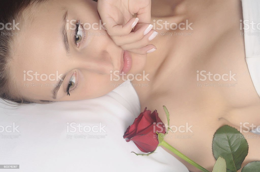woman with a red rose royalty-free stock photo