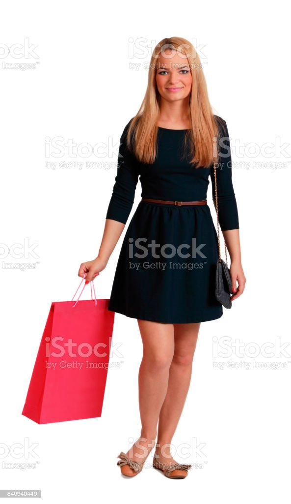 Woman with a Red Shopping Bag Walking stock photo