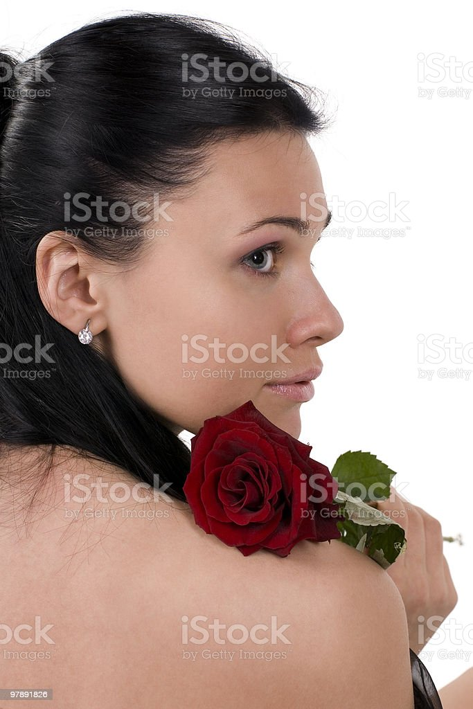 Woman   with a rose on the bared shoulder. royalty-free stock photo