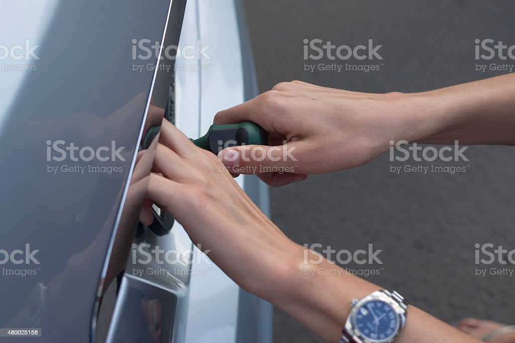 Woman With A Screwdriver stock photo