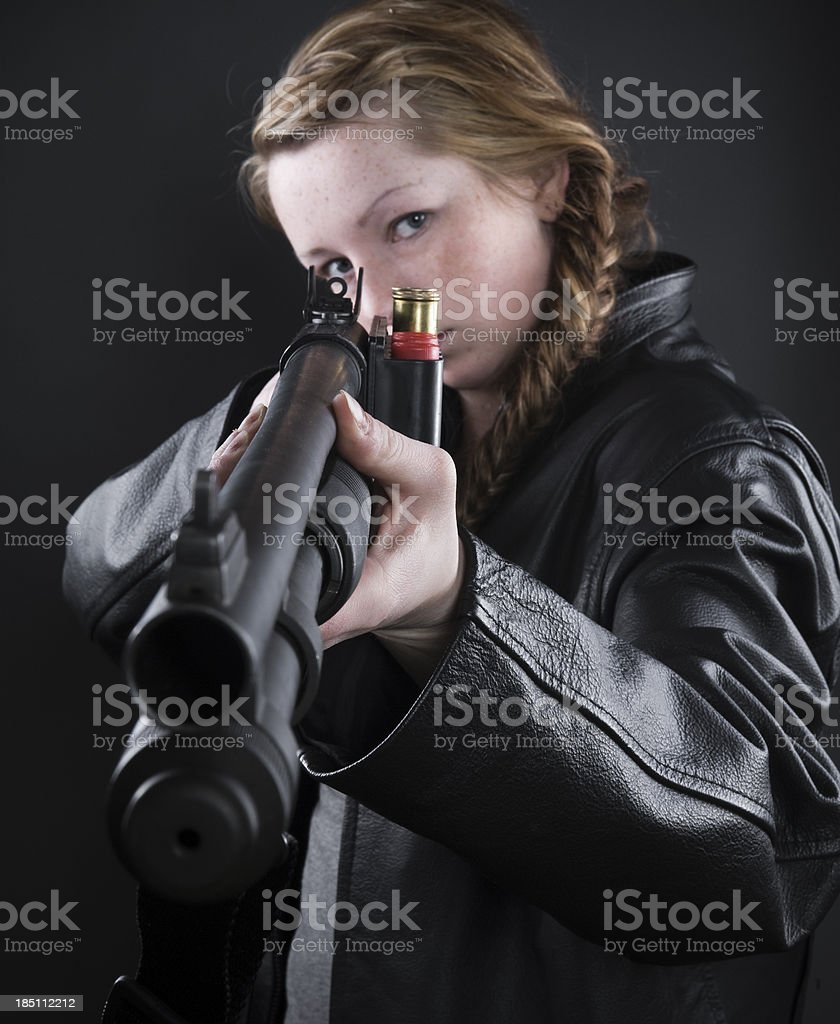 Woman with a Shotgun royalty-free stock photo
