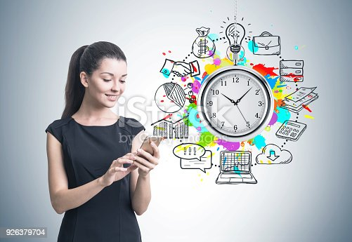 895493084 istock photo Woman with a smartphone, time management 926379704