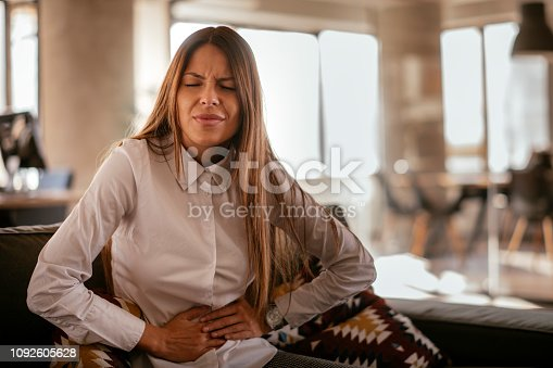 istock Woman with a stomach ache 1092605628