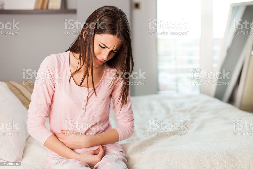 Woman with a stomach ache stock photo
