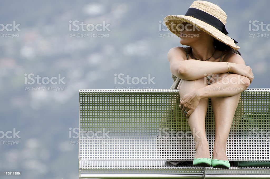 Woman with a straw hat stock photo