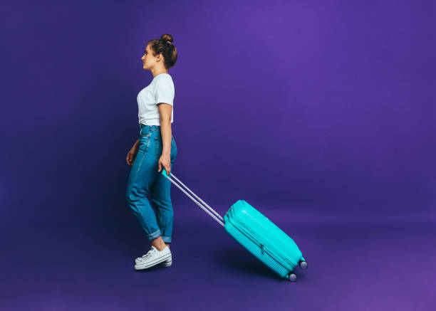 Woman with a suitcase Template with copy space stock photo