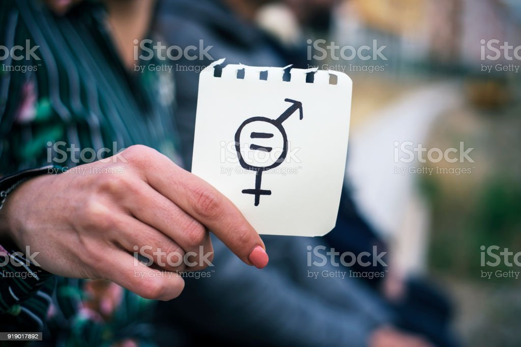woman with a symbol for gender equality stock photo