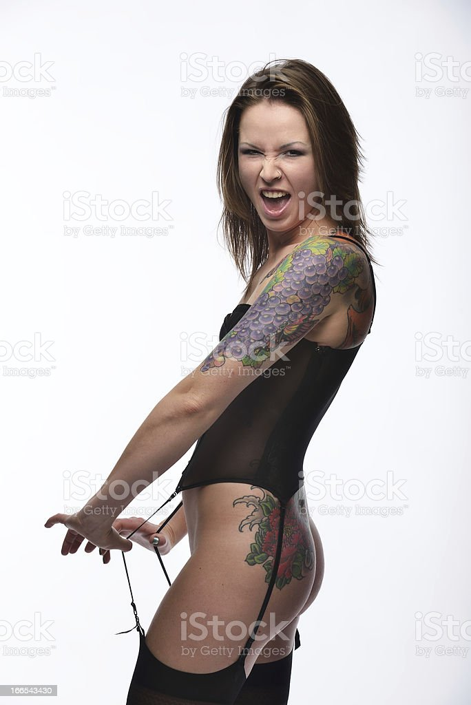 Woman with a tattoo against white background royalty-free stock photo
