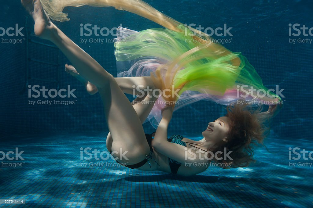 Woman with a tissue in the bottom pool. stock photo