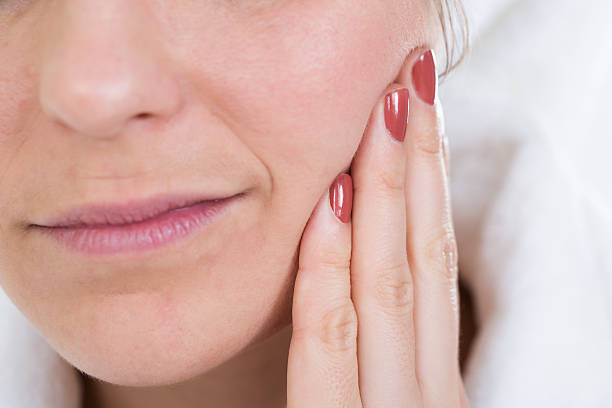 Woman With A Toothache Touching Face stock photo