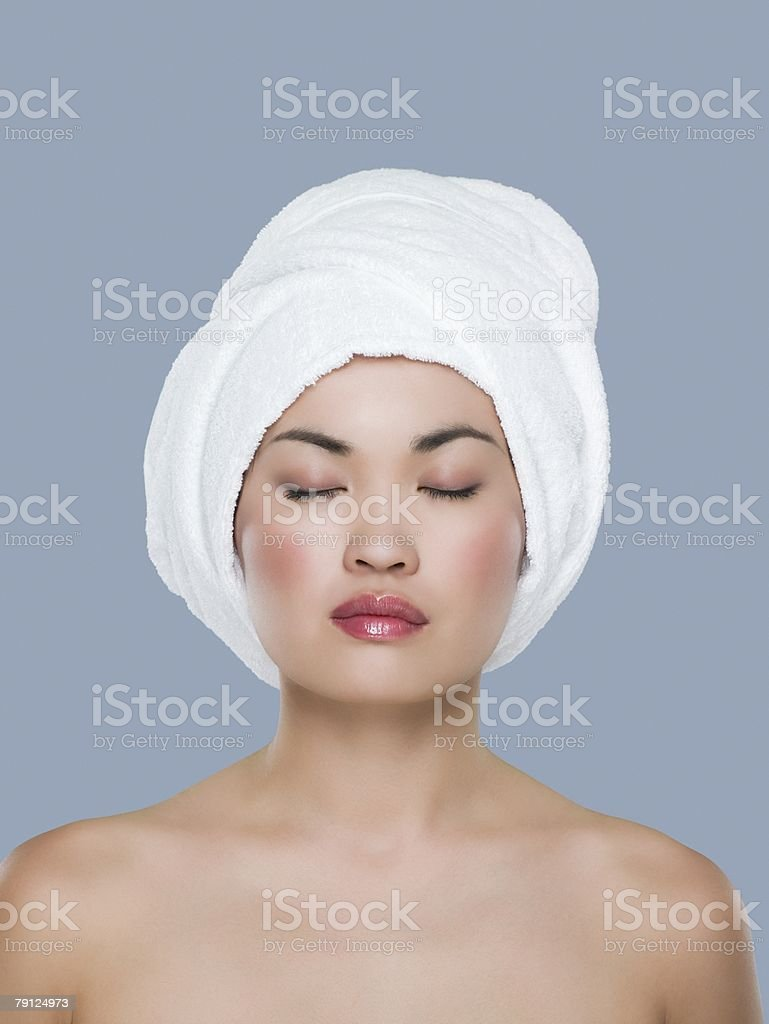 Woman with a towel on her head 免版稅 stock photo