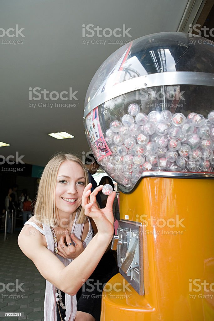 Woman with a toy from a vending machine royalty-free 스톡 사진