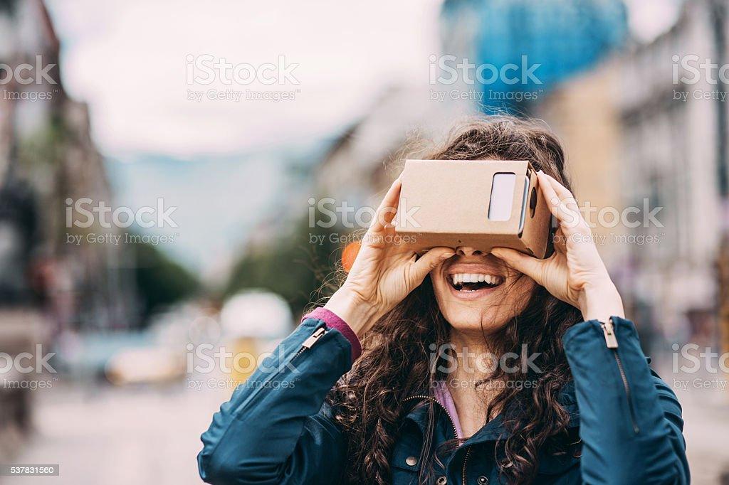 Woman with a virtual reality simulator stock photo