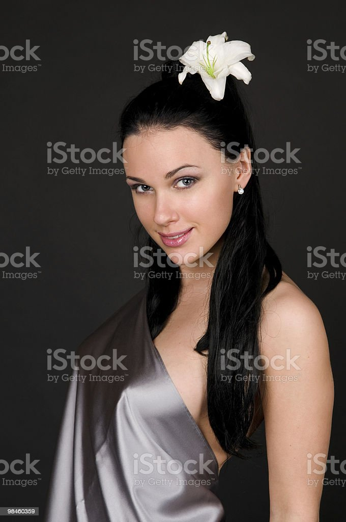 Woman with a white lily royalty-free stock photo