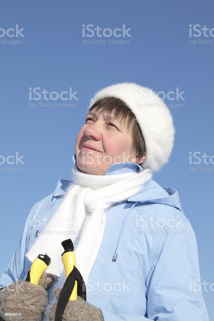 woman with a yellow ski poles royalty-free stock photo