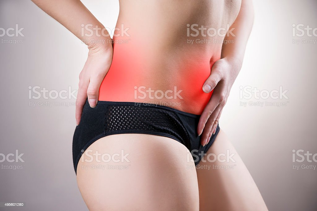 Woman with abdominal and back pain stock photo