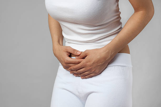 Woman with abdominal pain or cramps stock photo