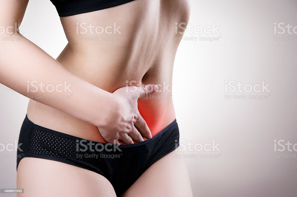 Woman with abdominal pain. Pain in the human body stock photo