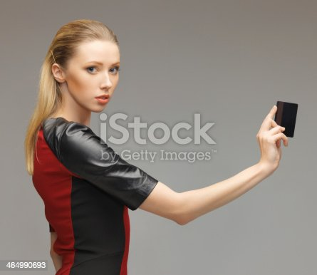 917307226 istock photo woman with access card 464990693