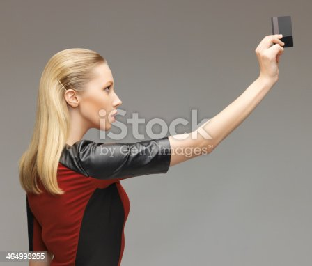 917307226 istock photo woman with access card 464993255