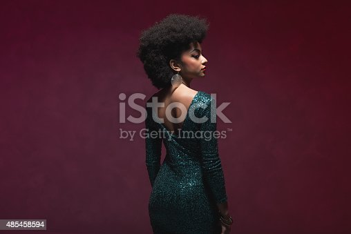 istock Woman with Afro in elegant sparkling dress 485458594