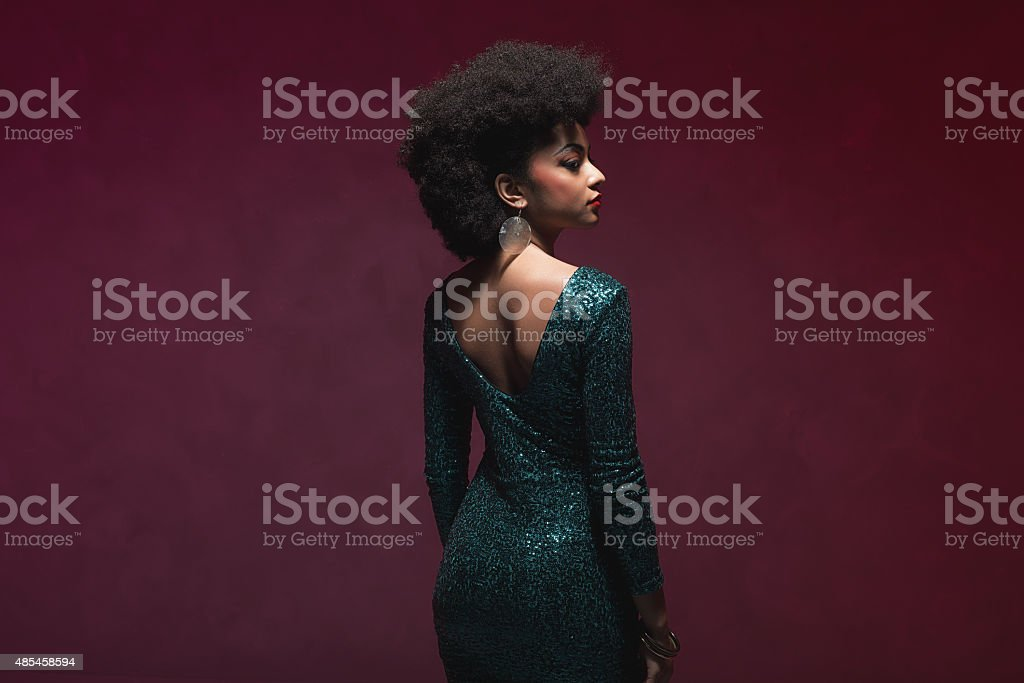 Woman with Afro in elegant sparkling dress stock photo