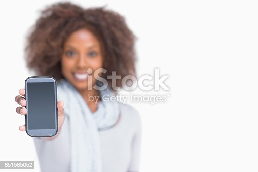 istock Woman with afro showing her smartphone 851565052