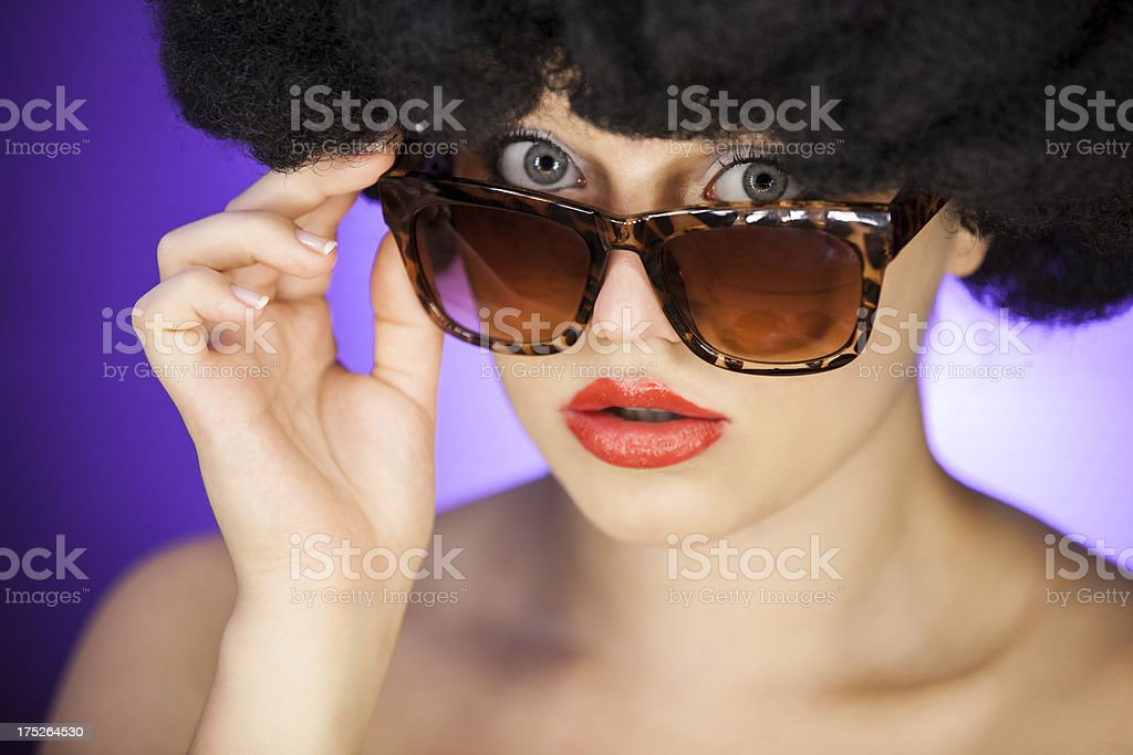 Woman With Afro Wig And Sunglasses royalty-free stock photo