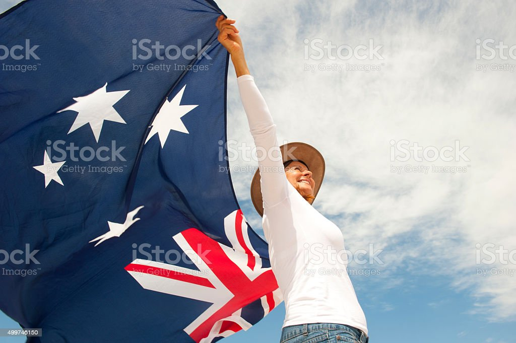 Woman with akubra hat and Australian flag stock photo