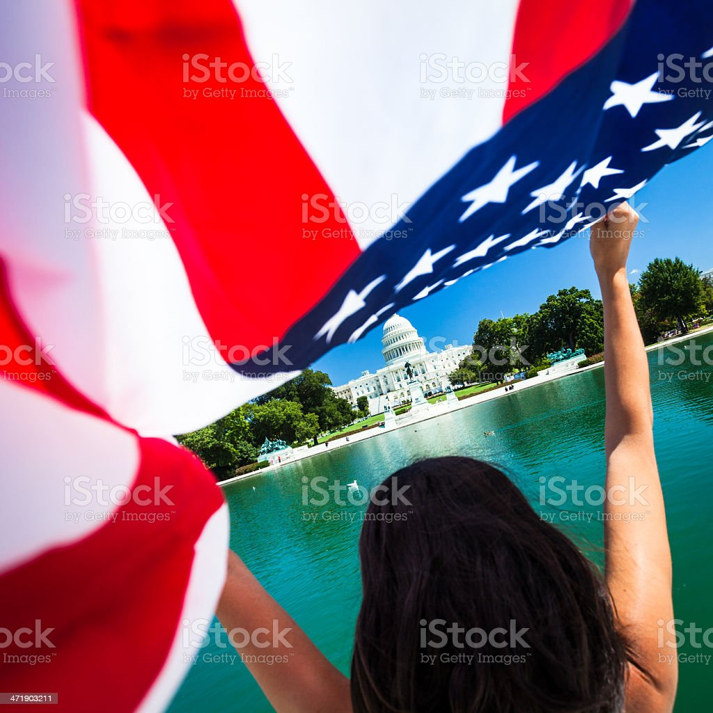 Woman with American Flag at Capitol Hill in Washington, USA royalty-free stock photo