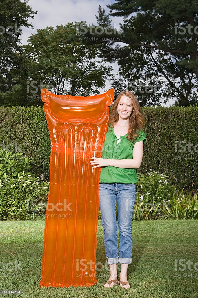 Woman with an inflatable mattress royalty-free stock photo