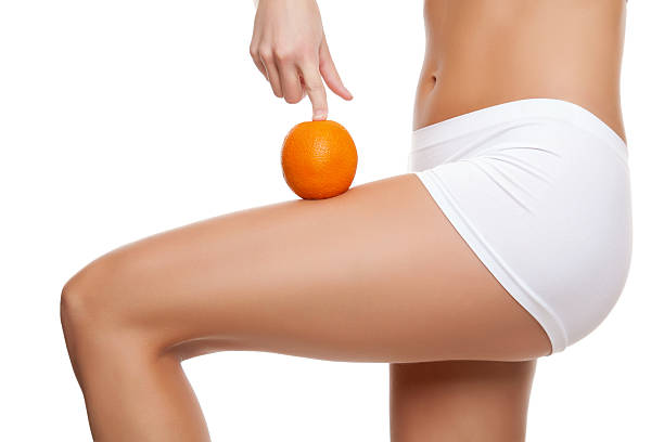 Frau mit einem orange mit perfekte Haut – Foto