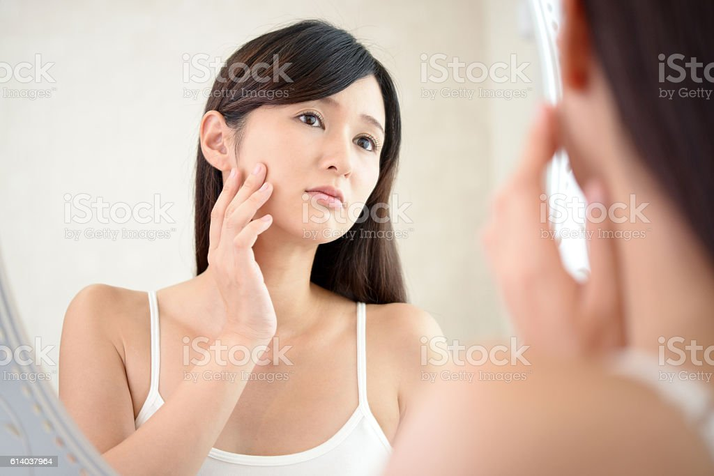 Woman with an uneasy look. stock photo