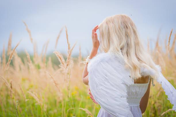 Cтоковое фото Женщина с Ангел крылья на спине