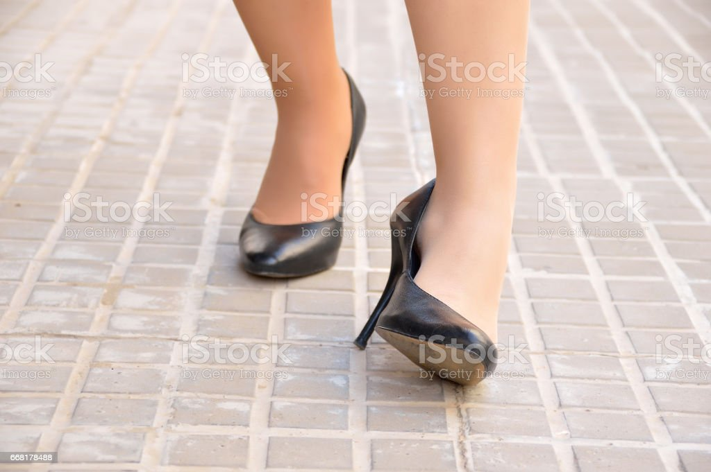 woman with ankle twisted stock photo