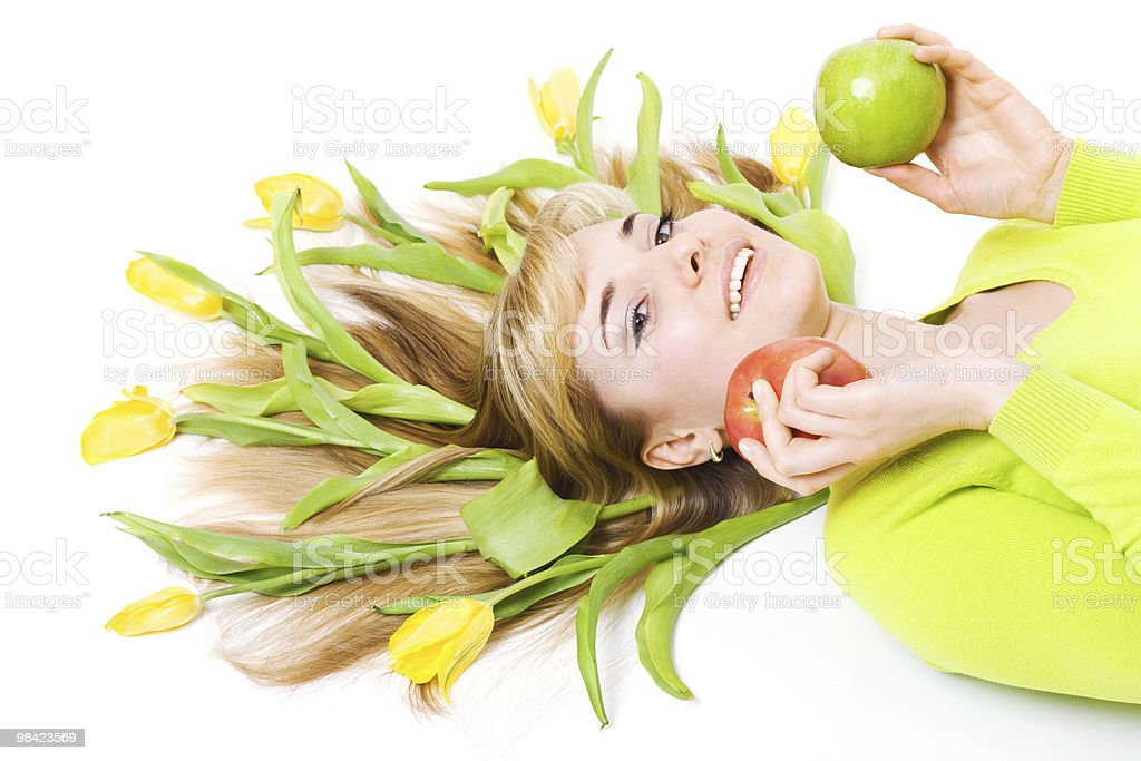 Woman with apple and bouquet of tulips in her hair royalty-free stock photo