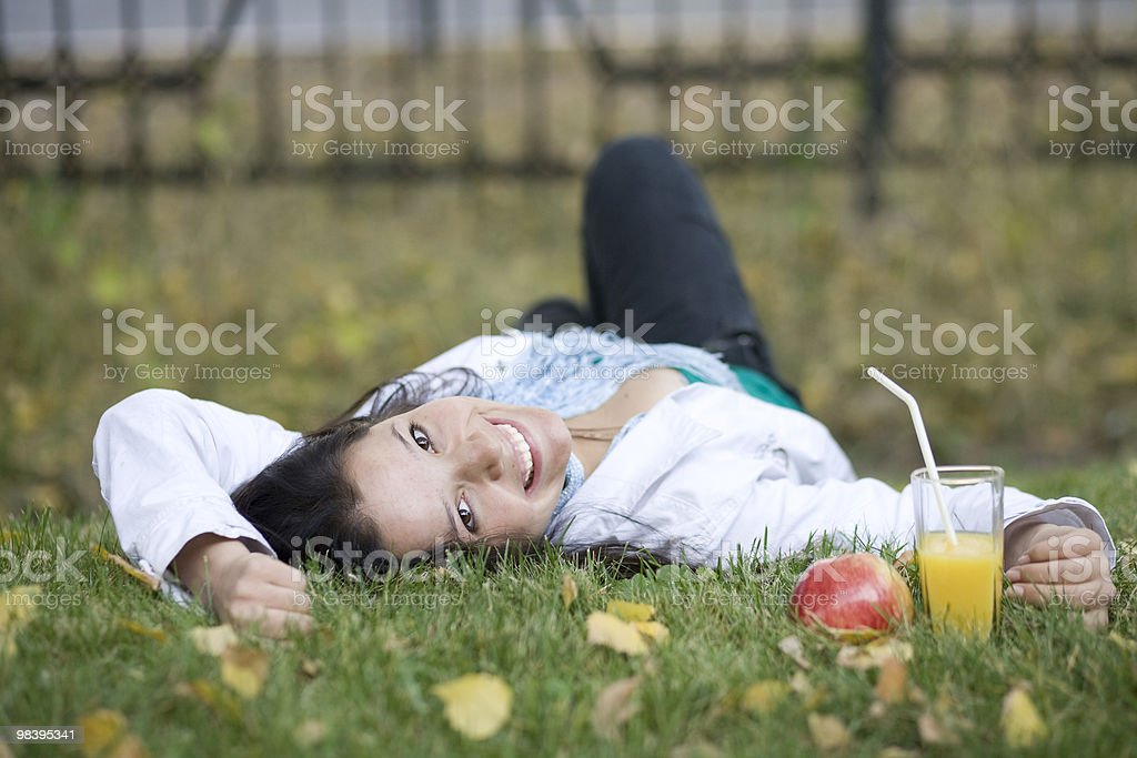 Woman with apple and juice at the summer park stock photo