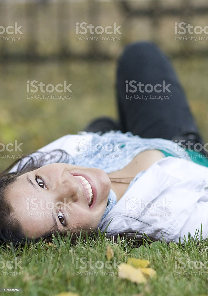 Woman with apple at the summer park royalty free stockfoto