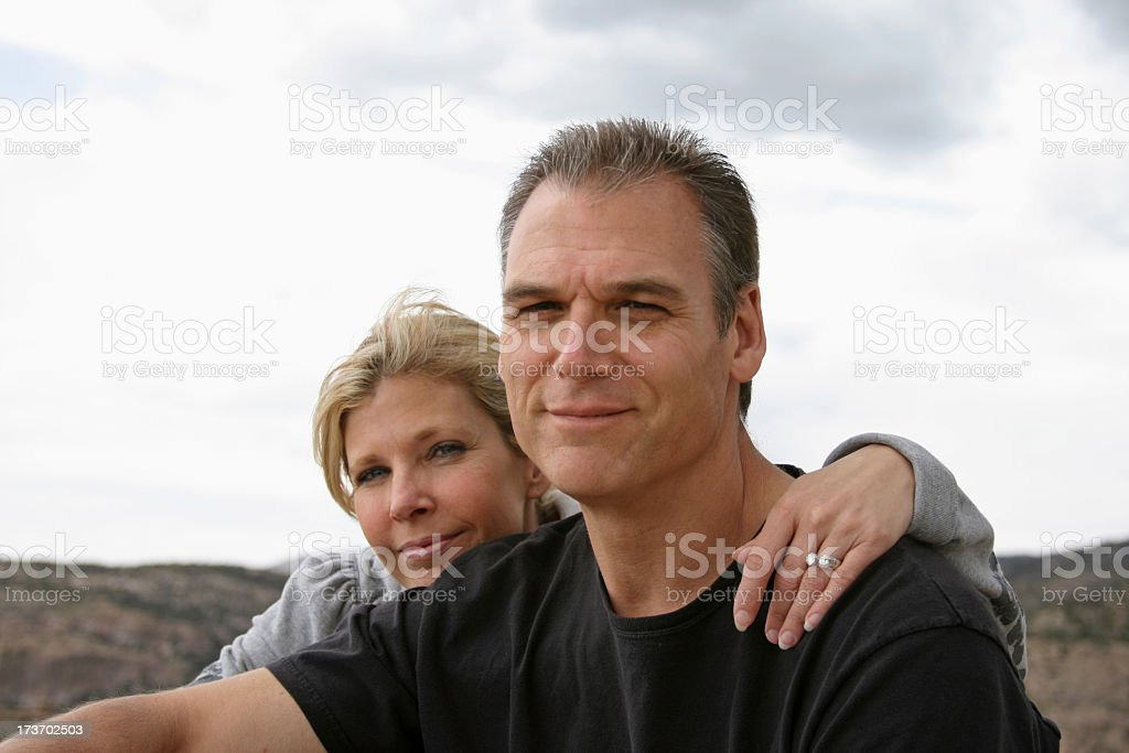 Woman with arm round neck of man royalty-free stock photo