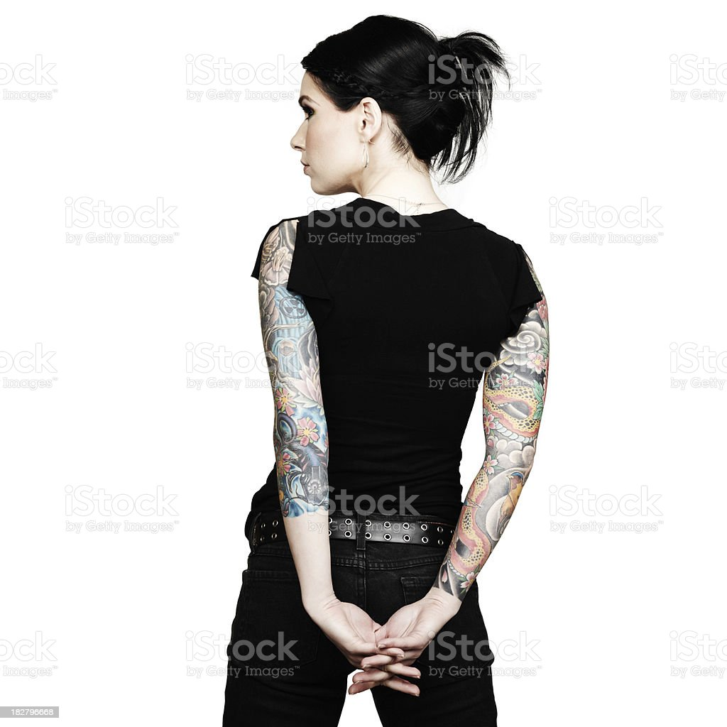 Woman with Arm Sleeve Tattoos Interlaces Her Fingers. Rear View. stock photo