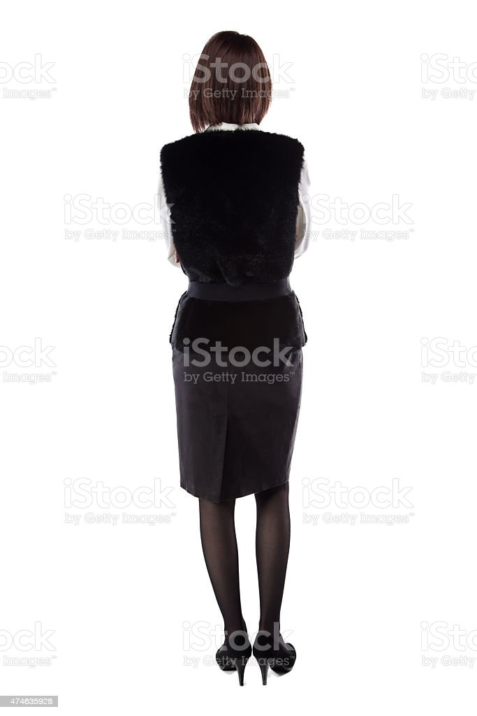 Woman with arms crossed turned back stock photo