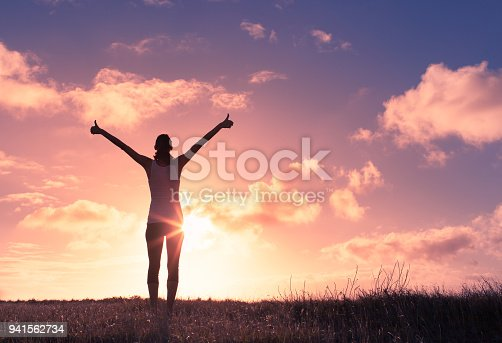 952953174 istock photo Woman with arms in the air giving thumbs up. 941562734