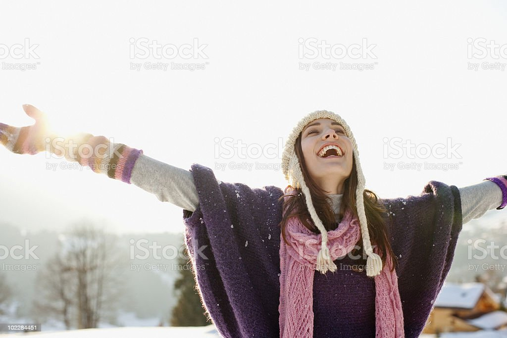 Woman with arms outstretched in snow royalty-free stock photo